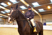 A happy Harrow resident, Robin Blake, horse riding