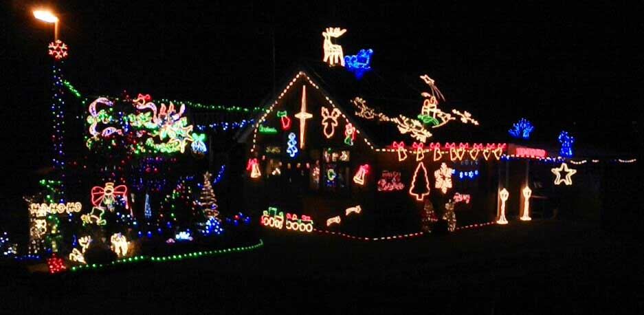 Alzheimer's Society supporters raise funds by decorating their house in Christmas lights